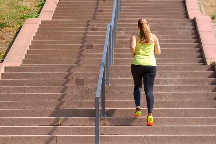 Girl jogging up steps