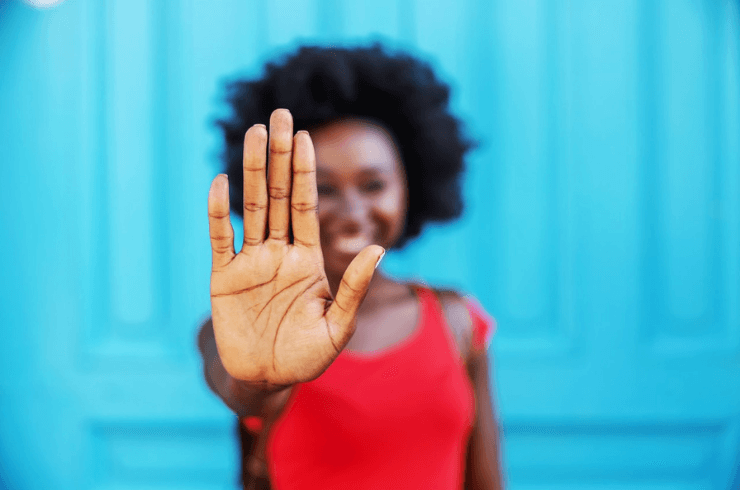 African American Woman Putting Up Hand to say Stop