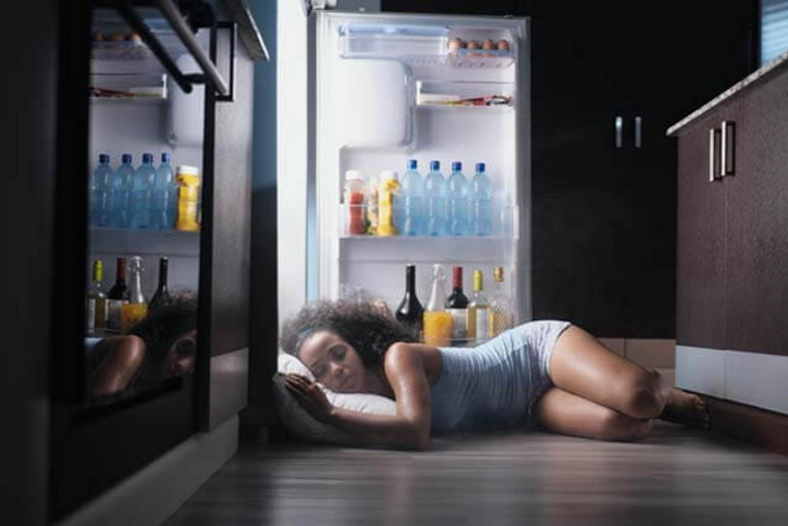 Sleeping in front of a open fridge
