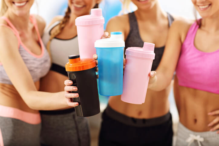 girls holding blender bottles