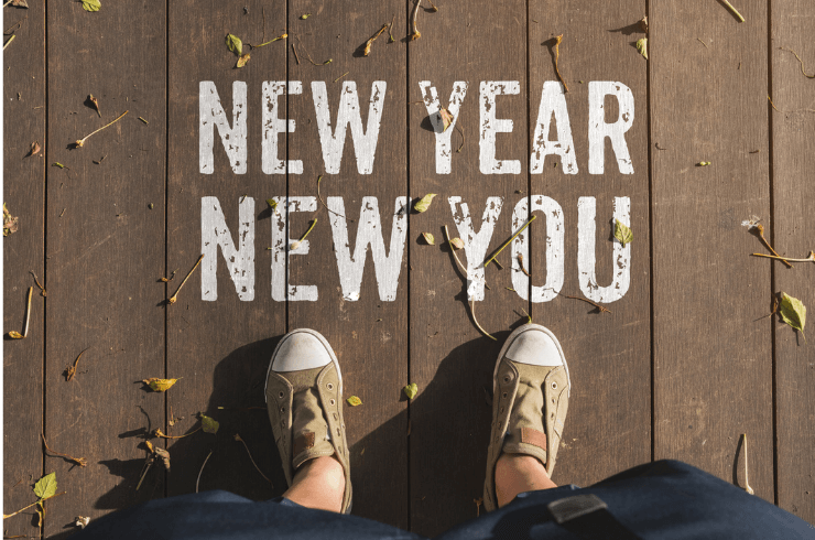 Person standing over New Year New You statement with shoes showing