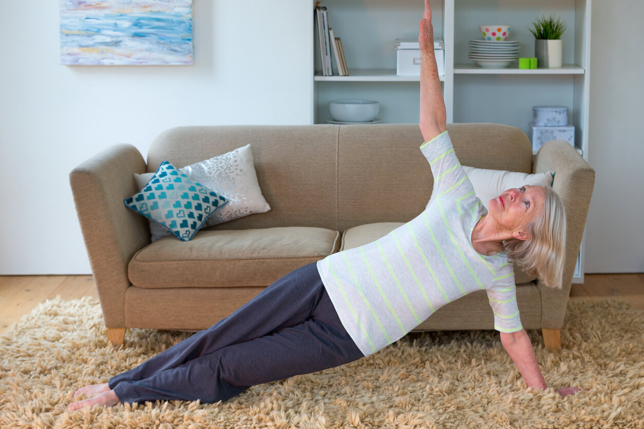 Older Woman preforming Yoga