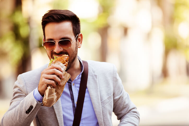 Business man eating wrap