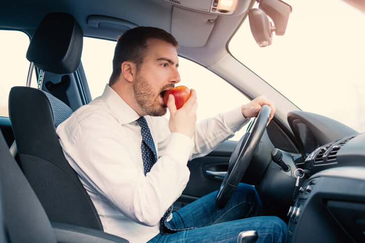 Eating apple in car